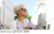 Купить «senior woman or tourist walking with city guide», видеоролик № 29037998, снято 21 августа 2018 г. (c) Syda Productions / Фотобанк Лори