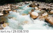 Купить «Mountain river, landscape of nature. Pure clear water moves among large stones», видеоролик № 29038510, снято 19 января 2020 г. (c) Константин Шишкин / Фотобанк Лори