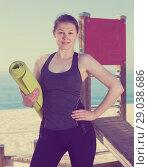 Купить «Woman standing after workout outdoors», фото № 29038686, снято 8 мая 2017 г. (c) Яков Филимонов / Фотобанк Лори