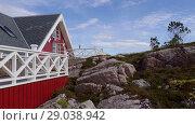 Купить «Red wooden house on rocky lanscape in sunny weather, Averoy, Norway», видеоролик № 29038942, снято 1 сентября 2018 г. (c) Некрасов Андрей / Фотобанк Лори