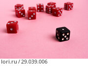 Купить «Red and black gaming dices on pink background», фото № 29039006, снято 3 января 2018 г. (c) Pavel Biryukov / Фотобанк Лори