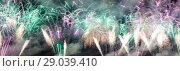 Купить «Celebratory colorful fireworks exploding in the skies», фото № 29039410, снято 10 августа 2013 г. (c) Владимир Журавлев / Фотобанк Лори