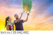Купить «happy couple launching chinese sky lantern», фото № 29042682, снято 31 августа 2013 г. (c) Syda Productions / Фотобанк Лори