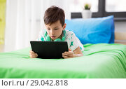 Купить «boy with tablet pc computer playing game at home», фото № 29042818, снято 19 апреля 2018 г. (c) Syda Productions / Фотобанк Лори