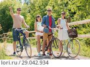 Купить «happy friends riding fixed gear bicycles in summer», фото № 29042934, снято 7 июля 2018 г. (c) Syda Productions / Фотобанк Лори