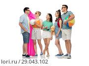 Купить «happy friends with beach and summer accessories», фото № 29043102, снято 30 июня 2018 г. (c) Syda Productions / Фотобанк Лори