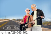 Купить «senior couple with electric guitar over route 66», фото № 29043162, снято 16 июля 2017 г. (c) Syda Productions / Фотобанк Лори