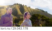 Купить «couple with earphones running over big sur hills», фото № 29043178, снято 17 октября 2015 г. (c) Syda Productions / Фотобанк Лори