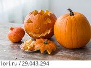 Купить «jack-o-lantern or carved halloween pumpkin», фото № 29043294, снято 15 сентября 2017 г. (c) Syda Productions / Фотобанк Лори