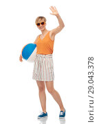 Купить «smiling teenage girl in sunglasses with beach ball», фото № 29043378, снято 30 июня 2018 г. (c) Syda Productions / Фотобанк Лори