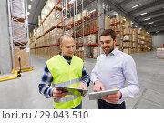 Купить «worker and businessman with tablet pc at warehouse», фото № 29043510, снято 9 декабря 2015 г. (c) Syda Productions / Фотобанк Лори