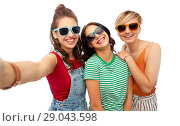Купить «happy female friends in sunglasses taking selfie», фото № 29043598, снято 30 июня 2018 г. (c) Syda Productions / Фотобанк Лори
