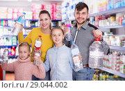 family holding bottled mineral water. Стоковое фото, фотограф Яков Филимонов / Фотобанк Лори