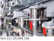 Купить «Photo of new shining dishes in the store», фото № 29044126, снято 5 февраля 2018 г. (c) Яков Филимонов / Фотобанк Лори