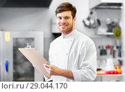 Купить «chef with clipboard doing inventory at restaurant», фото № 29044170, снято 2 апреля 2017 г. (c) Syda Productions / Фотобанк Лори