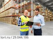 Купить «worker and businessman with tablet pc at warehouse», фото № 29044186, снято 9 декабря 2015 г. (c) Syda Productions / Фотобанк Лори