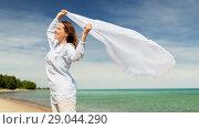 Купить «happy woman with shawl waving in wind on beach», фото № 29044290, снято 15 июня 2018 г. (c) Syda Productions / Фотобанк Лори