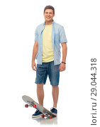 Купить «smiling young man with skateboard over white», фото № 29044318, снято 30 июня 2018 г. (c) Syda Productions / Фотобанк Лори