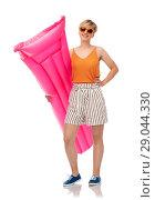 Купить «teenage girl in sunglasses with pool mattress», фото № 29044330, снято 30 июня 2018 г. (c) Syda Productions / Фотобанк Лори
