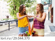 Купить «teenage girls with skateboards making fist bump», фото № 29044370, снято 19 июля 2018 г. (c) Syda Productions / Фотобанк Лори