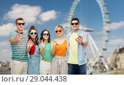 Купить «friends in sunglasses showing ok over ferry wheel», фото № 29044438, снято 30 июня 2018 г. (c) Syda Productions / Фотобанк Лори