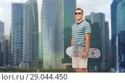 Купить «young man with skateboard over singapore city», фото № 29044450, снято 30 июня 2018 г. (c) Syda Productions / Фотобанк Лори