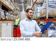 Купить «happy businessman with clipboard at warehouse», фото № 29044486, снято 9 декабря 2015 г. (c) Syda Productions / Фотобанк Лори