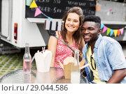 Купить «mixed race couple taking selfie at food truck», фото № 29044586, снято 1 августа 2017 г. (c) Syda Productions / Фотобанк Лори