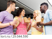 Купить «happy friends with drinks eating at food truck», фото № 29044590, снято 1 августа 2017 г. (c) Syda Productions / Фотобанк Лори