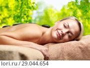 Купить «close up of woman having hot stone massage in spa», фото № 29044654, снято 18 декабря 2014 г. (c) Syda Productions / Фотобанк Лори