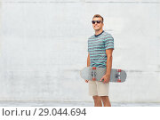 Купить «smiling young man with skateboard over white», фото № 29044694, снято 30 июня 2018 г. (c) Syda Productions / Фотобанк Лори