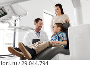 Купить «mother and son visiting dentist at dental clinic», фото № 29044794, снято 22 апреля 2018 г. (c) Syda Productions / Фотобанк Лори