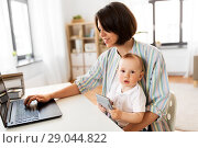Купить «working mother with baby boy and laptop at home», фото № 29044822, снято 12 мая 2018 г. (c) Syda Productions / Фотобанк Лори