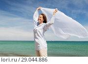 Купить «happy woman with shawl waving in wind on beach», фото № 29044886, снято 15 июня 2018 г. (c) Syda Productions / Фотобанк Лори