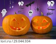Купить «close up of halloween pumpkins on table», фото № 29044934, снято 17 сентября 2014 г. (c) Syda Productions / Фотобанк Лори
