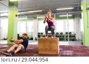 Купить «woman and man with medicine ball exercising in gym», фото № 29044954, снято 19 февраля 2017 г. (c) Syda Productions / Фотобанк Лори