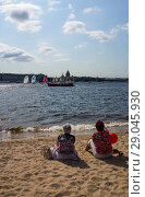 Купить «Saint Petersburg. People are watching Yacht Races from different cities of Russia in the National Sailing League on the sandy bank of the Neva River.August 18, 2018», фото № 29045930, снято 18 августа 2018 г. (c) Виктория Катьянова / Фотобанк Лори