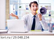 Купить «Businessman with loudspeaker in the office», фото № 29048234, снято 18 сентября 2017 г. (c) Elnur / Фотобанк Лори