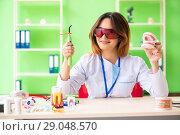 Купить «Woman dentist working on teeth implant», фото № 29048570, снято 11 июня 2018 г. (c) Elnur / Фотобанк Лори