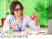 Купить «Woman dentist working on teeth implant», фото № 29048578, снято 11 июня 2018 г. (c) Elnur / Фотобанк Лори
