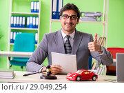 Купить «Young handsome lawyer working in the office», фото № 29049254, снято 22 мая 2018 г. (c) Elnur / Фотобанк Лори