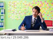 Купить «Businessman with many conflicting priorities», фото № 29049286, снято 23 мая 2018 г. (c) Elnur / Фотобанк Лори