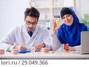 Купить «Dentist doctor and assistant working on new tooth implant», фото № 29049366, снято 24 апреля 2018 г. (c) Elnur / Фотобанк Лори