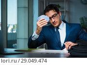 Купить «Young business playing cards late in office», фото № 29049474, снято 9 октября 2017 г. (c) Elnur / Фотобанк Лори