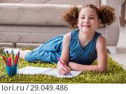 Купить «Young little girl drawing on paper with pencils», фото № 29049486, снято 24 июня 2017 г. (c) Elnur / Фотобанк Лори