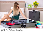 Купить «Young woman getting ready for summer vacation», фото № 29049750, снято 29 июня 2018 г. (c) Elnur / Фотобанк Лори