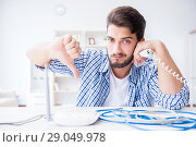 Купить «Frustrated young man due to weak internet reception», фото № 29049978, снято 6 июля 2017 г. (c) Elnur / Фотобанк Лори