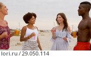 Купить «friends with non alcoholic drinks on beach», видеоролик № 29050114, снято 24 августа 2018 г. (c) Syda Productions / Фотобанк Лори
