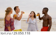 Купить «friends clinking non alcoholic drinks on beach», видеоролик № 29050118, снято 24 августа 2018 г. (c) Syda Productions / Фотобанк Лори