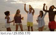 Купить «happy friends dancing at summer beach party», видеоролик № 29050170, снято 24 августа 2018 г. (c) Syda Productions / Фотобанк Лори